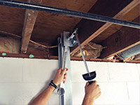 Straightening a foundation wall with the PowerBrace™ i-beam system in a Shrewsbury home.