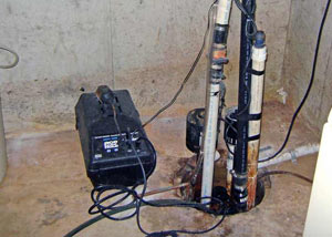 Pedestal sump pump system installed in a home in Greenfield